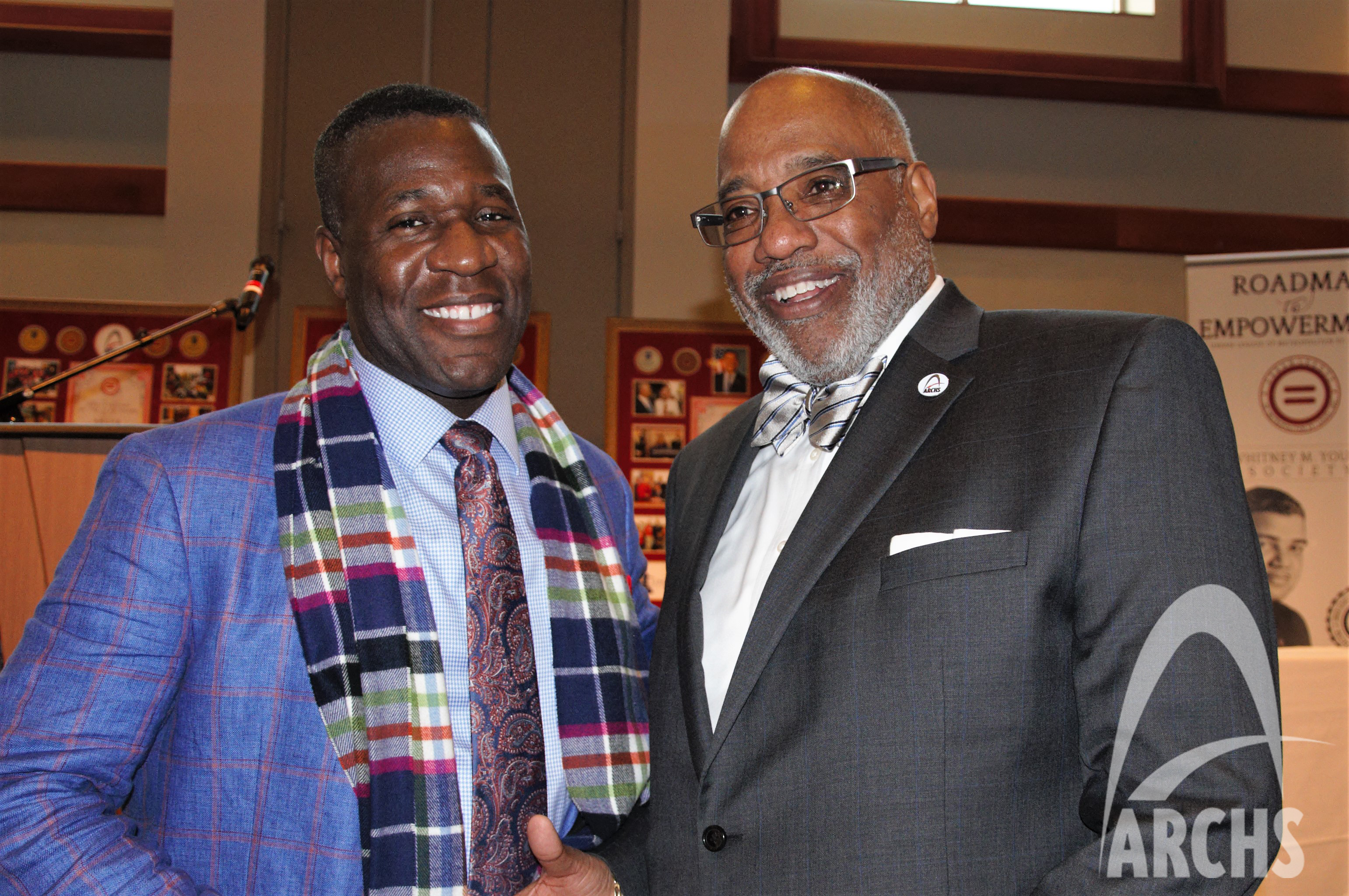 Wendell Kimbrough shaking hands with Dr. Art McCoy