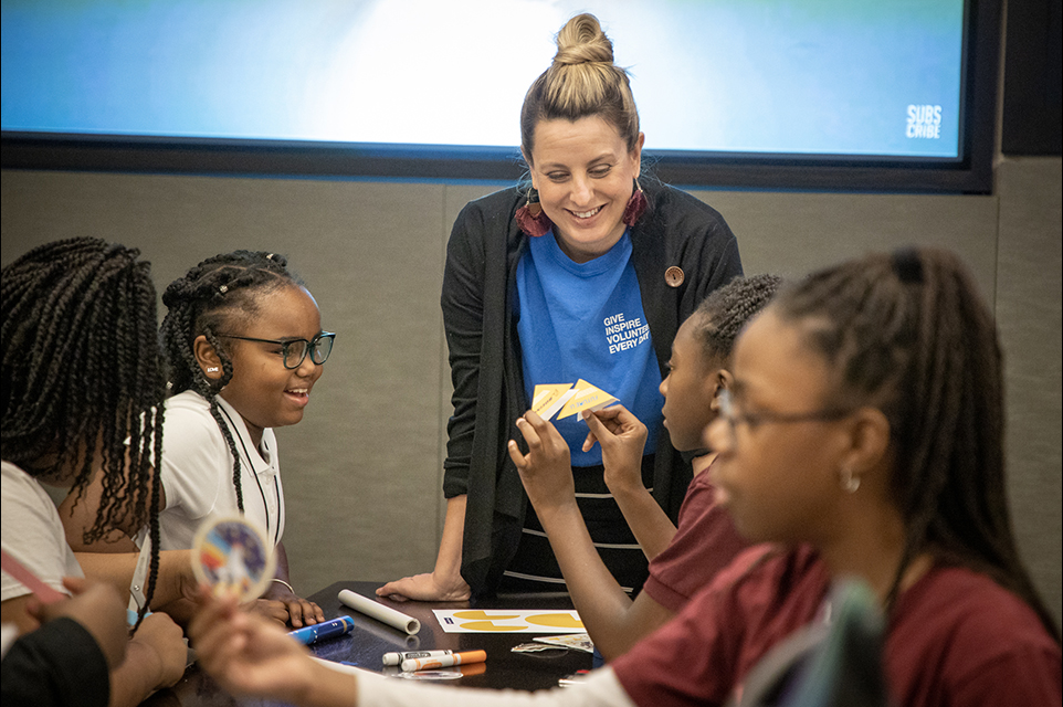 A Boeing volunteer helps students construct stomp rockets during the Launch Lab competition in Chicago.